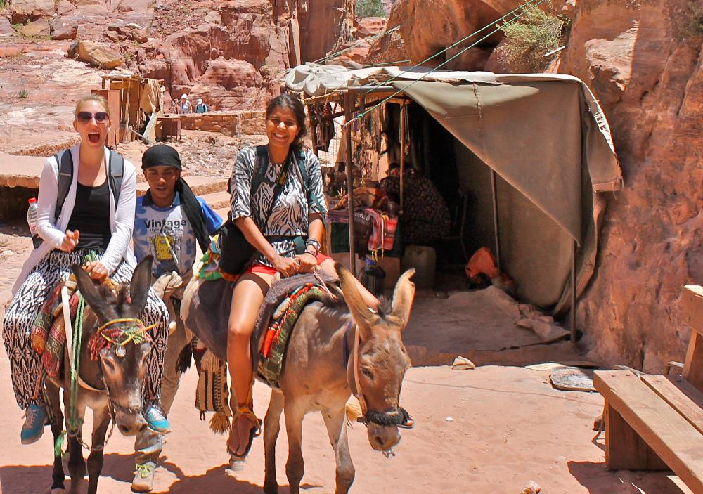 riding a donkey in Petra, Jordan