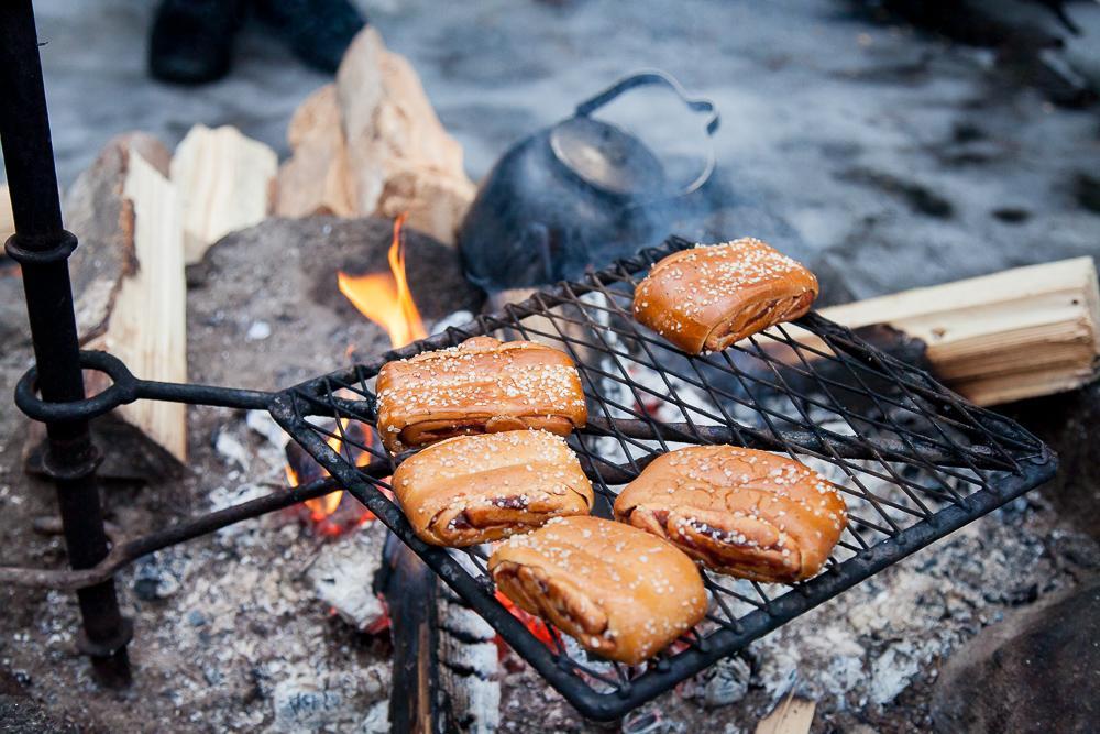 finnish korvapuusti heated over a fire nuuksio park espoo finland