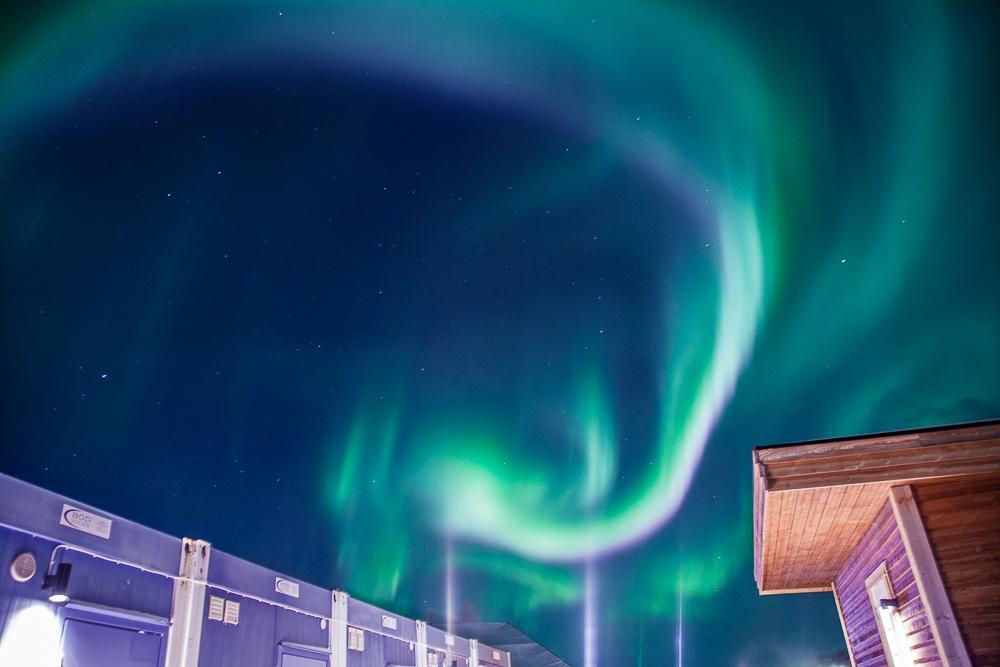 pink and green northern lights in abisko sweden lapland photo