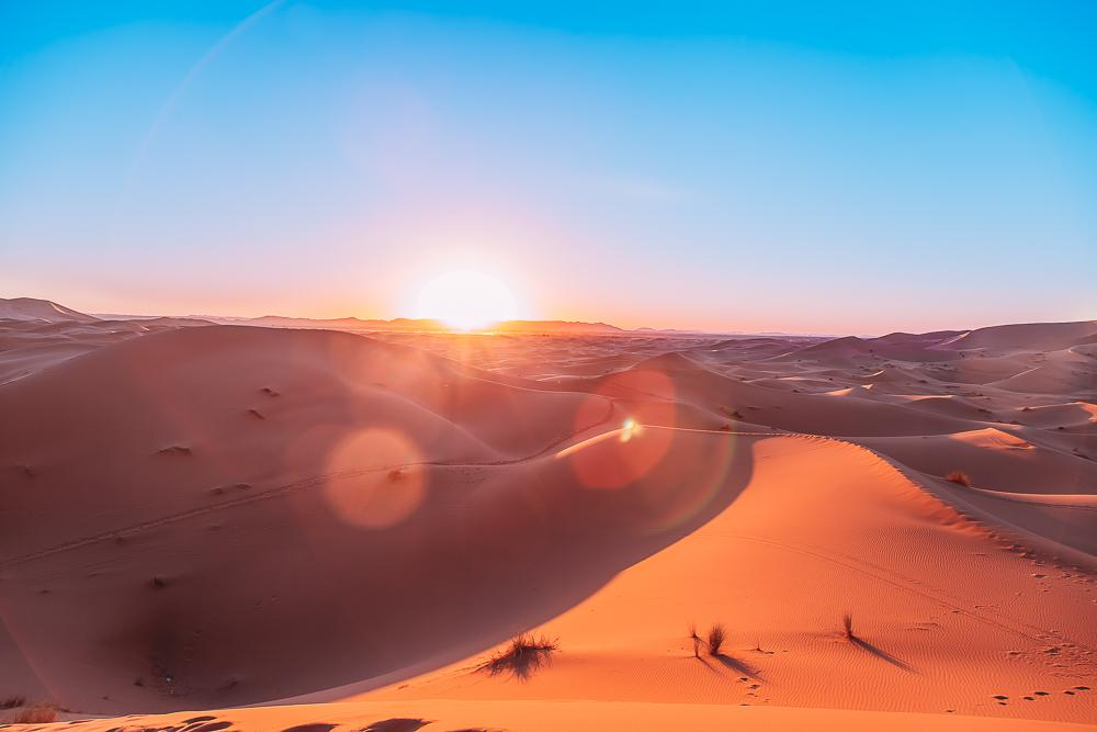 sahara desert camel trek tour merzouga morocco sand dunes photo sunset