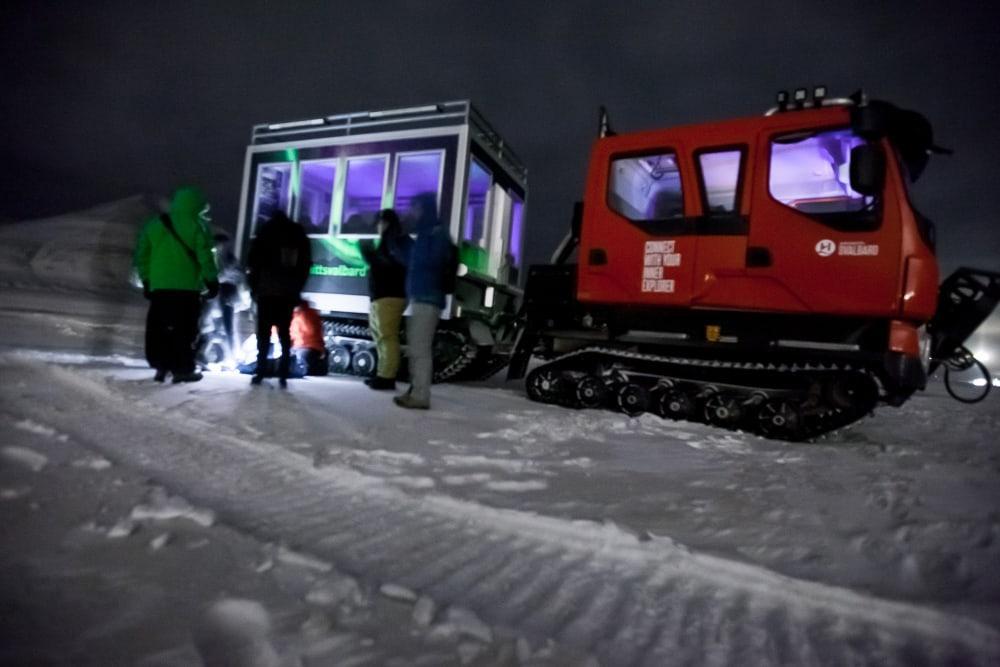 svalbard northern lights tour snowcat